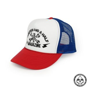 13 and a half Magazine Trucker cap